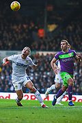 Kalvin Phillips of Leeds United (23) heads the ball away under pressure during the EFL Sky Bet Championship match between Leeds United and Bristol City at Elland Road, Leeds, England on 24 November 2018.