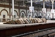 India, Uttar Pradesh, Agra, The Agra Fort Train Station sack on the platform