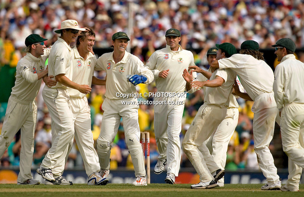 Australian bowler Glenn McGrath is congratulated after taking the wicket of Pietersen on day one of the 5th Ashes test match between Australia and England at the Sydney Cricket Ground, Sydney, Australia on 2 January, 2007.  *EDITORIAL NZ USE ONLY**NO AGENTS**<br /> <br /> scg cricket cricketer 020107 celebration celebrating celebrate