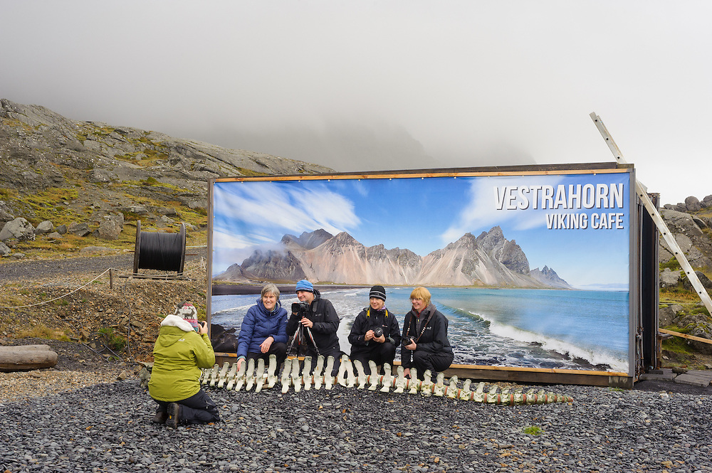 Photographers in front of image of the mountains behind, Vestrahorn, Iceland