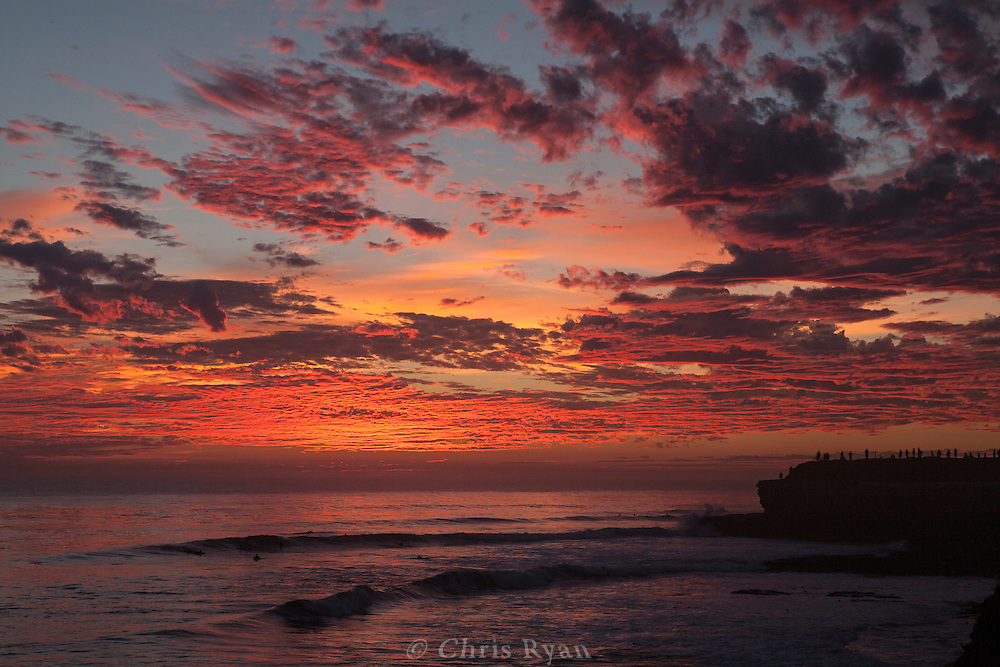 People line the cliffs to watch the sunset, West Cliff Drive, Santa Cruz, California