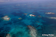 Silk Cayes, with three chartered yachts anchored offshore and patch reefs inside Belize Barrier Reef,  near Placencia, Stann Creek District, Southern Belize, Central America, Gladden Spit and Silk Cayes Marine Reserve ( Caribbean Sea )