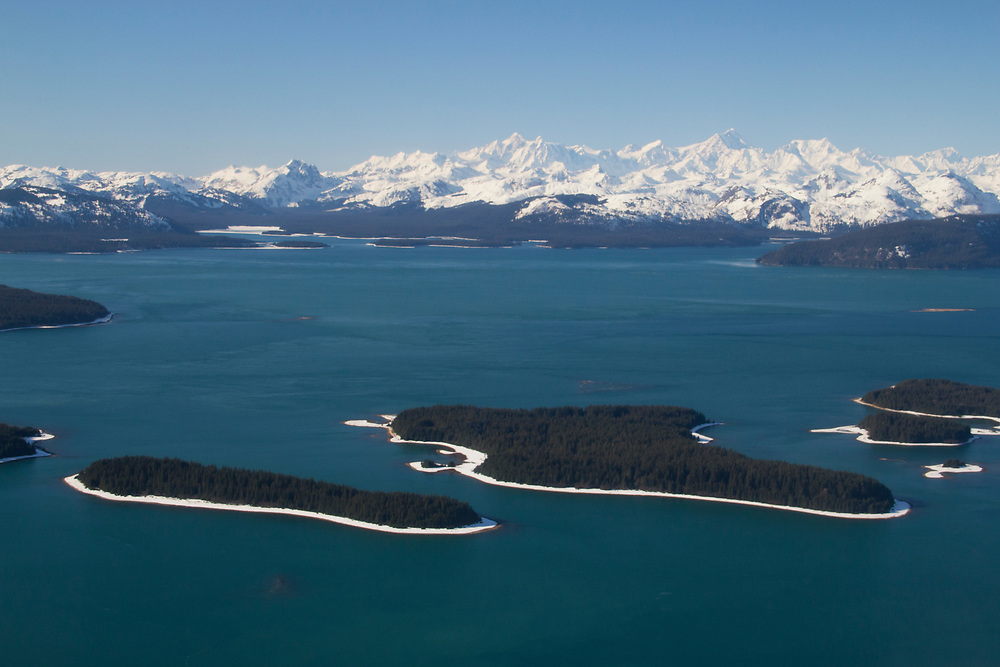 An aerial shot of the Beardslee Islands and the Fairweather Mountain Range 15,320'.