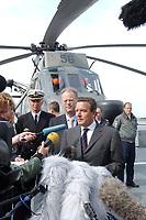 09 AUG 2001, ROSTOCK/GERMANY:<br /> Gerhard Schroeder, SPD, Bundeskanzler, und Rudolf Scharping, SPD, Bundesverteidigungsminister, waehrend einem Pressestatement auf dem Hubschrauberlandedeck des Tenders DONAU (im Hintergrund ein SEA KING Hubschrauber), waehrend einem Besuch von Marineeinheiten<br /> IMAGE: 20010809-01-021<br /> KEYWORDS: Bundeswehr, Bundesmarine, Marine, Gerhard Schröder, Kamera, Mikrofon, microphone, camera