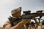 As their command post comes under attack, Private Michael Newton of the 82nd Airborne, 1/508, Alpha Company, Third Platoon, points out the enemy position in Sangin, Helmand province, Afghanistan on Thursday, April 5, 2007. The firefight, less than 24 hours into the air assault on Sangin raged for over five hours.