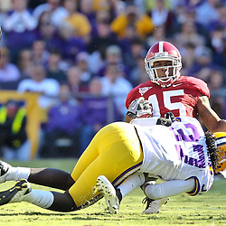 November 6, 2010; Baton Rouge, LA, USA; Alabama Crimson Tide wide receiver Darius Hanks (15) is tackled by LSU Tigers safety Karnell Hatcher (37)  during the first half at Tiger Stadium.  Mandatory Credit: Derick E. Hingle