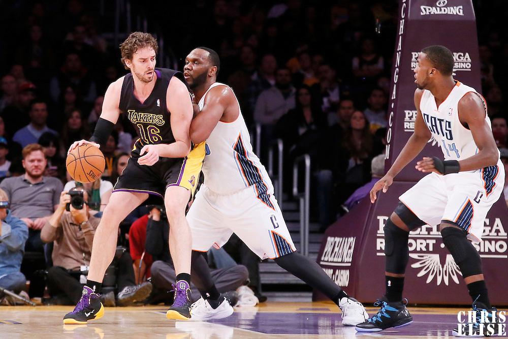 31 January 2014: Los Angeles Lakers center Pau Gasol (16) posts up Charlotte Bobcats center Al Jefferson (25) during the Charlotte Bobcats 110-100 victory over the Los Angeles Lakers at the Staples Center, Los Angeles, California, USA.