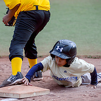 Brewer Zeth Villasana (12) dives back to third base to avoid a pickoff from Pirate Micah Lincoln (11) Thursday at Ford Canyon Park.
