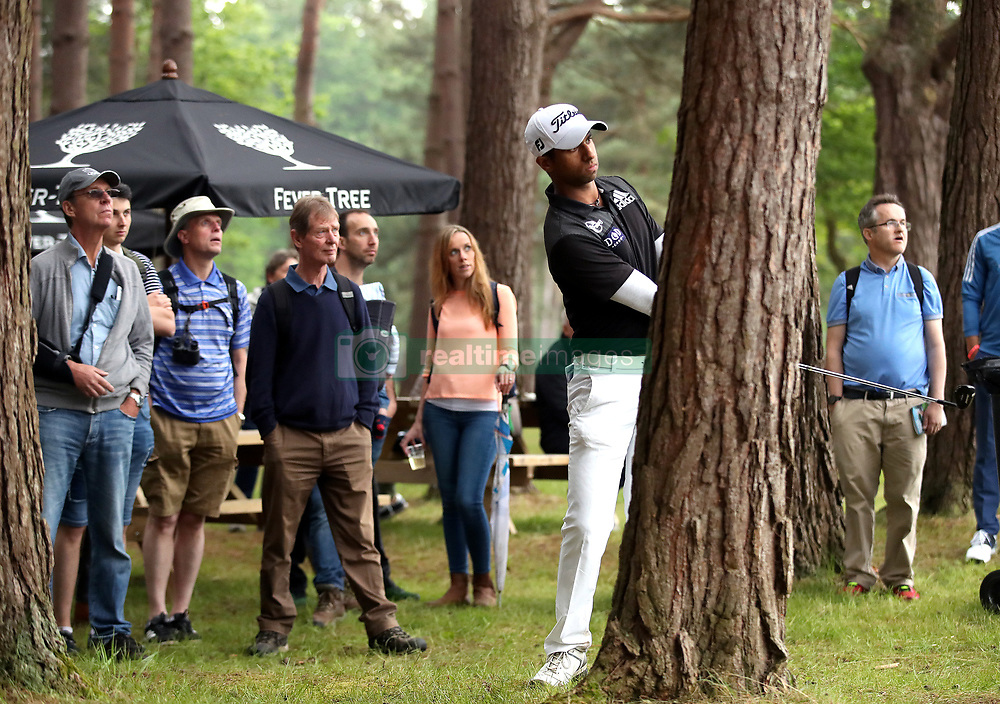 England's Aaron Rai plays out of the rough behind a tree on the 13th hole during day two of the 2018 BMW PGA Championship at Wentworth Golf Club, Surrey.
