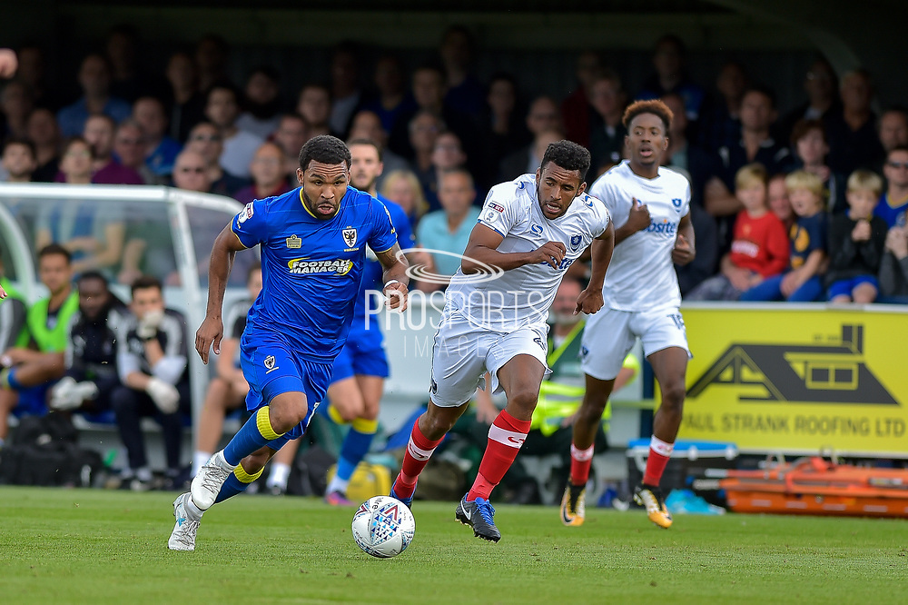 AFC Wimbledon Midfielder, Andy Barcham (17) runs at the portsmouth defence during the EFL Sky Bet League 1 match between AFC Wimbledon and Portsmouth at the Cherry Red Records Stadium, Kingston, England on 9 September 2017. Photo by Adam Rivers.