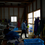 May 28, 2013 - Togura, Japan: Fishermen of Togura, at a storage shed in the local port after collecting ropes used to grow sea weed. Togura, a small fishing village in Minami Sanriku, was vastly destroyed by the 2011 tsunami that hit the northeast coast of Japan. Thousands died and hundreds of families lost their houses, business and boats. The recovering community works now in a cooperative system where the few remaining boats, spared by the tsunami, are shared by all. (Paulo Nunes dos Santos)