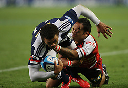Brian Habana is tackled by James Kamana during the Super Rugby (Super 15) fixture between the DHL Stormers and the Lions held at DHL Newlands Stadium in Cape Town, South Africa on 26 February 2011. Photo by Jacques Rossouw/SPORTZPICS