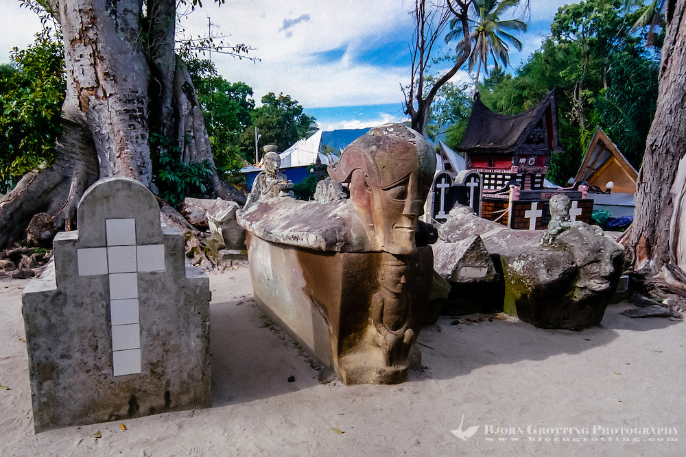 Indonesia, Sumatra. Samosir. The grave of King Sidabatu in Tomok. The tombstone has the kings image carved on the front, along with his bodyguard and the woman he loved, Anteng Melila Senega.