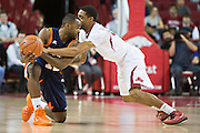 FAYETTEVILLE, AR - DECEMBER 19:  DeMarc Richardson #15 of the UT Martin Skyhawks has the ball knocked away by Mardracus Wade #1 of the Arkansas Razorbacks at Bud Walton Arena on December 19, 2013 in Fayetteville, Arkansas.  The Razorbacks defeated the Skyhawks 102-56.  (Photo by Wesley Hitt/Getty Images) *** Local Caption *** DeMarc Richardson