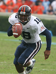 University of Virginia QB Marques Hagans (18) rushes up field against UNC.  The Cavaliers fell to North Carolina 7-5 on October 22, 2005.<br />