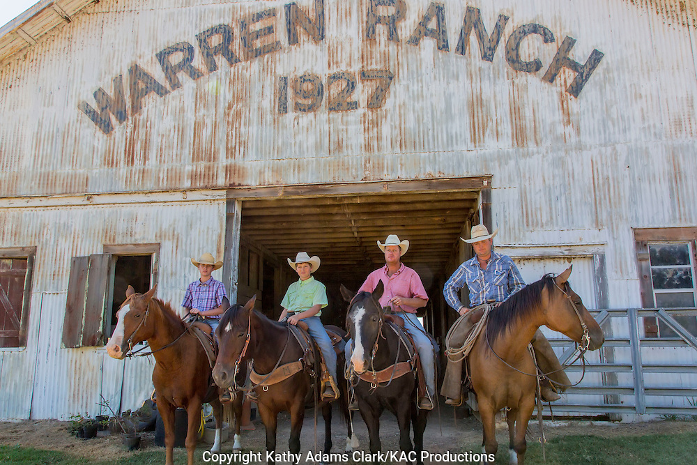 Horses and riders in front of barn at Warren Ranch at Katy Prairie Conservancy; Katy; Texas. Ciowboys left to right are Brady McDonald; Colby McDonald; Stephen McDonald and Clint Mazurkiewicz.
