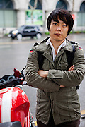 Portrait of a student  and motorcycle fan wearing a German Army jacket in the center of Seoul.