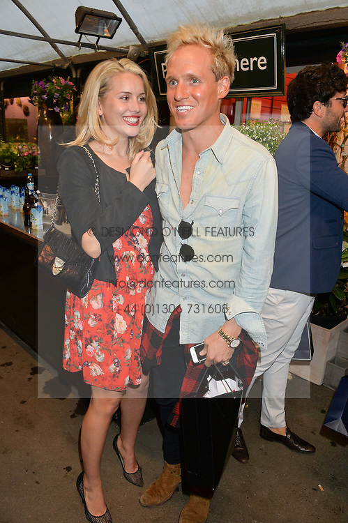 CAGGIE DUNLOP and JAMIE LAING at a party to celebrate the launch of the Taylor Morris Eyewear's Summer Collection held at The Chelsea Gardner, 125 Sydney Street, London on 20th May 2015.