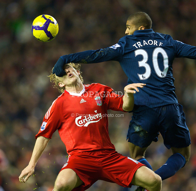 LIVERPOOL, ENGLAND - Sunday, December 13, 2009: Liverpool's Dirk Kuyt is brought down in the box by Arsenal's Armand Traore's arm during the Premiership match at Anfield. (Photo by: David Rawcliffe/Propaganda)