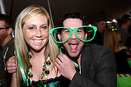 Amanda Ward of Kettering (left) and Kevin Brown of Matter of Chance mug for the camera at the WTUE St. PatROCKS Party at Flanagan's Pub in Dayton, Saturday, March 17, 2012.