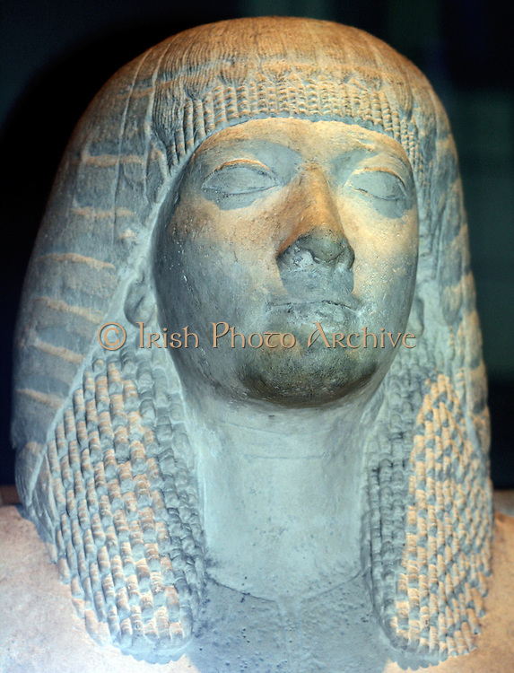 18th Dynasty Egyptian dyad of man and wife. Made of limestone and dated approximately 1350 BC.