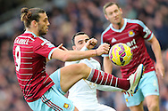 Andy Carroll of West Ham United battles with Leon Britton of Swansea City during the Barclays Premier League match at the Boleyn Ground, London<br /> Picture by Richard Calver/Focus Images Ltd +447792 981244<br /> 07/12/2014