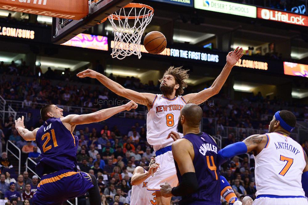 Mar 9, 2016; Phoenix, AZ, USA; New York Knicks center Robin Lopez (8) blocks Phoenix Suns center Alex Len (21) while driving to the basket in the first half at Talking Stick Resort Arena. Mandatory Credit: Jennifer Stewart-USA TODAY Sports