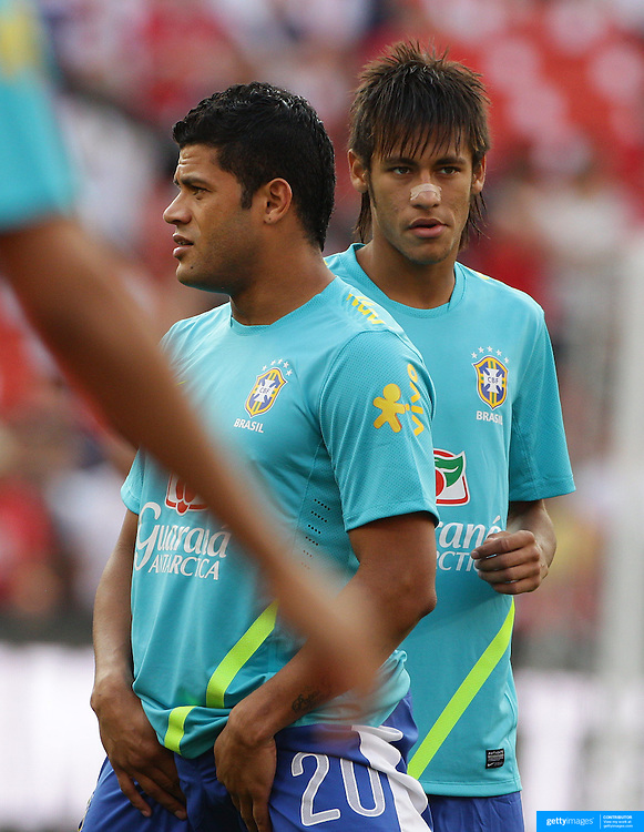 Hulk, (left) and Neymar, Brazil, during warm up before the USA V Brazil International friendly soccer match at FedEx Field, Washington DC, USA. 30th May 2012. Photo Tim Clayton