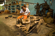 Master craftsman Pranava Stapathy works on a large statue of Hanuman, the monkey God at the workshop of S. Devasenapathy Stapathy and Sons..The current Stpathy family is the twenty third generation of bronze casters dating back to the founding of the Chola Empire. The Stapathys had been sculptors of stone idols at the time of Rajaraja 1 (AD985-1014) but were called to Tanjore to learn bronze casting. Their methods using the 'lost wax' process remains unchanged to this day.