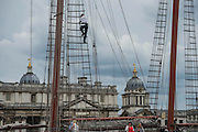 The JR Tolkien passing Greenwich with a man in the rigging - Royal Greenwich Tall Ships Festival with a fleet of square rigged ships moored on the Thames at Greenwich and Woolwich. The fleet includes two of the biggest Class A Tall Ships - the Dar Mlodziezy and Santa Maria Manuela - which are moored on Tall Ships Island in the river off Greenwich. Tall Ships Festival Day on Saturday 29 August featured free family entertainment and the chance to enjoy a taste of life on the high seas.