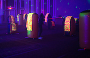 Students and their sibs lined up to play laser tag in the Baker Ballroom during the Glo Party on Sibs Weekend.
