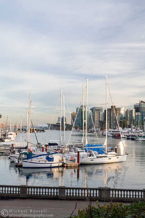 Sailboats docked at the Royal Vancouver Yacht Club and Vancouver Rowing Club.  Photographed from the Stanley Park seawall along the western end of Coal Harbour in Vancouver, British Columbia, Canada