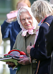 The Queen with her winners rosettes after her horse Barbers Shop won Class 78 at the Royal Windsor Horse Show, Friday, May 10th 2013.  Photo by: Stephen Lock / i-Images