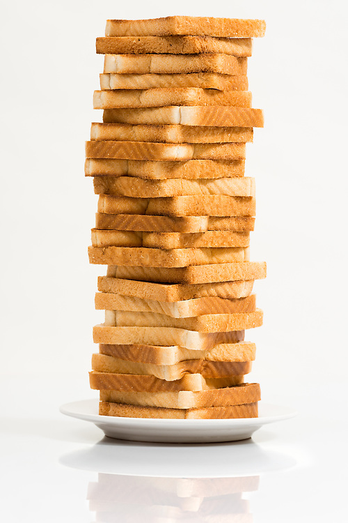 Tower of toasted bread against a white background