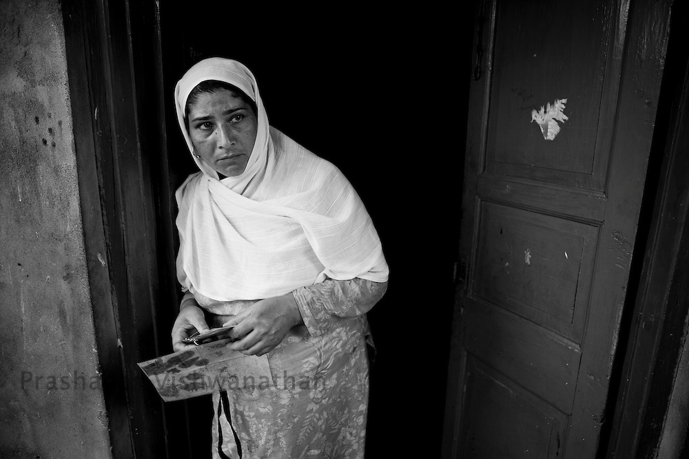 A widow awaiting her hsband for 14 years after being taken away for questioning, September 2011, Kashmir, India. Photographer: Prashanth Vishwanathan