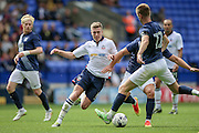 Josh Vela (Bolton Wanderers) attacking run is stopped by the Preston North End Players during the Pre-Season Friendly match between Bolton Wanderers and Preston North End at the Macron Stadium, Bolton, England on 30 July 2016. Photo by Mark P Doherty.