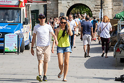 © Licensed to London News Pictures. 07/08/2020. London, UK. Members of the public enjoy the sunshine next to the River Thames at Richmond in South West London as temperatures are expected to reach to 35c today. Thousands of sun seekers have flocked to parks, rivers and the south coast as temperatures soar with beaches and roads becoming jammed with holidaymakers. The heat is set to continue for the rest of the week with temperatures expected in the high 20s. Photo credit: Alex Lentati/LNP