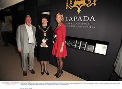 Left to right, MICHAEL GOLDING Deputy Chairman of LAPADA, COUNCILLOR JUDITH WARNER Lord Mayor of Westminster and SARAH PERCY-DAVIS Chief Executive of LAPADA at a preview evening of the annual London LAPADA (The Association of Art & Antiques Dealers) antiques Fair held in Berkeley Square, London on 21st September 2010. *** Local Caption *** Image free to use for 1 year from image capture date as long as image is used in context with story the image was taken.  If in doubt contact us - info@donfeatures.com<br /> Left to right, MICHAEL GOLDING Deputy Chairman of LAPADA, COUNCILLOR JUDITH WARNER Lord Mayor of Westminster and SARAH PERCY-DAVIS Chief Executive of LAPADA at a preview evening of the annual London LAPADA (The Association of Art & Antiques Dealers) antiques Fair held in Berkeley Square, London on 21st September 2010.