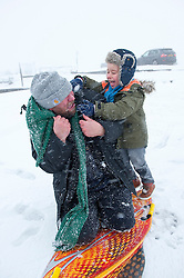 © Licensed to London News Pictures. 27/12/2014. Horseshoe Pass, Denbighshire, UK. Harry, 4 1/2,  has come from Hawarden, Flintshire, with his father Carl to play in the snow on his skidoo board. Snow continues to fall on high ground in Wales. Photo credit: Graham M. Lawrence/LNP
