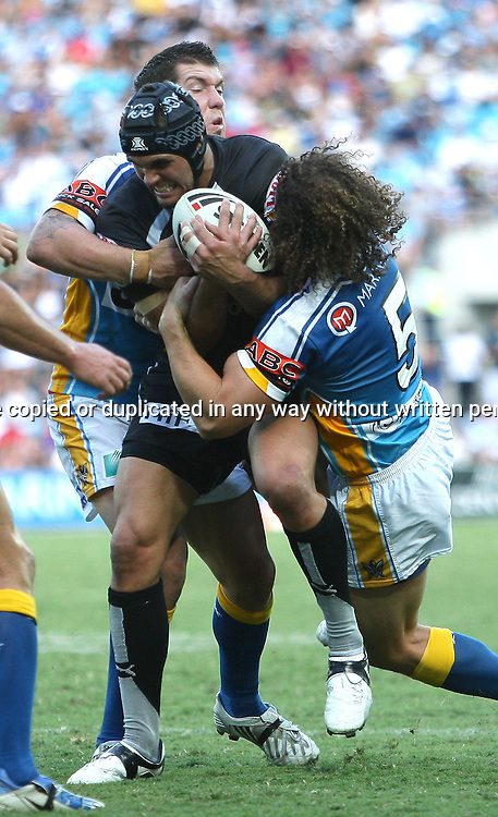 Ryan Shortland under pressure from Matt Petersen during round 7 of the NRL - Gold Coast Titans v New Zealand Warriors. Played at Skilled Stadium, Robina QLD. Titans (36) defeated the Warriors (24).  Photo: Warren Keir (Photosport NZ).<br /> <br /> Use information: This image is intended for Editorial use only (e.g. news or commentary, print or electronic). Any commercial or promotional use requires additional clearance.