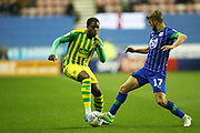 West Bromwich Albion defender Nathan Ferguson (36) and Wigan Athletic midfielder Michael Jacobs (17) during the EFL Sky Bet Championship match between Wigan Athletic and West Bromwich Albion at the DW Stadium, Wigan, England on 11 December 2019.