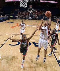 Virginia Cavaliers Forward Lyndra Littles (1) shoots over Miami Hurricanes guard Renee Taylor (3).  The University of Virginia Cavaliers defeated the Miami Hurricanes Women's Basketball Team 73-60 at the John Paul Jones Arena in Charlottesville, VA on February 4, 2007.