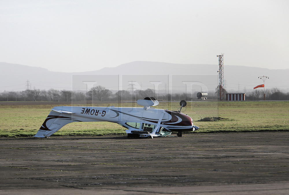 © Under licence to London News Pictures. 29/01/2016. A light aircraft blown over by the high winds of Storm Gertrude at Durham Tees Valley Airport near Middlesbrough, UK. Photo Credit: Stuart Boulton/LNP