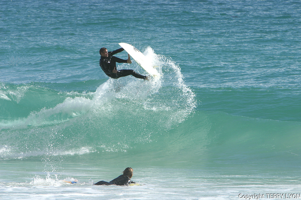 Porn star (His nickname) doing an ariel maneuver while surfing Cottesloe Beach.