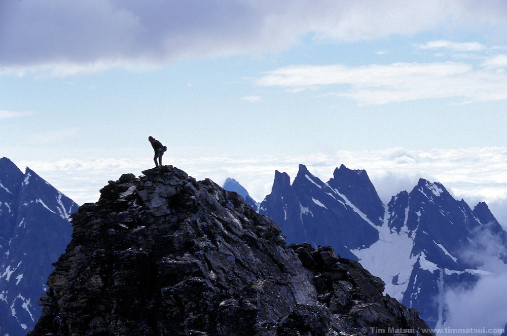 Forrest Murphy stands atop Luna Peak looking across the summits of the Southern Picket Range in the North Cascades National Park.