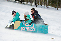 "Julia, Sarah and Nick Kelley get turned around and are heading south in their ""Miami Express"" sled during the Laconia Parks and Recreation cardboard sled derby on Thursday afternoon.   (Karen Bobotas/for the Laconia Daily Sun)"