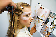 A Russian model receives make-up during the Fashion Week in Moscow. ..Photograph by Justin Jin