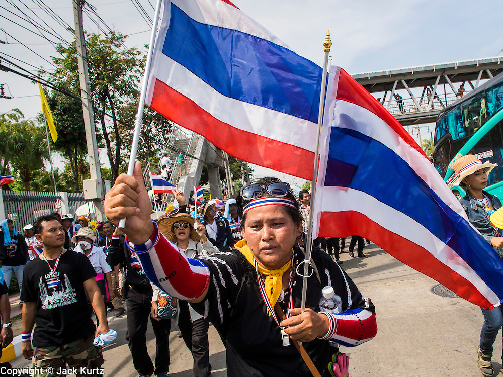 30 NOVEMBER 2013 - BANGKOK, THAILAND:  Anti-government protestors march up Chaeng Watthana Road, near the Government Complex in Bangkok Saturday. Political faultlines in Bangkok, the Thai capital, hardened Saturday. Antigovernment factions repeated promises to strike at the heart of Bangkok Sunday and bring down the government while thousands of Red Shirts, who support the government, have come to Bangkok from their base in rural Thailand to defend the government. Prime Minister Yingluck Shinawatra has appealed for calm, but her opponents have rejected all requests for negotiations saying the only acceptable outcome is the eradication of the government.       PHOTO BY JACK KURTZ