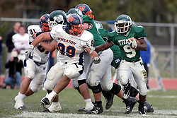 10 November 2007: Marcus Dunlop finds a large hole in the middle of the line. This game between the Wheaton College Thunder and the Illinois Wesleyan University Titans was for a share of the CCIW Championship and was played at Wilder Field on the campus of Illinois Wesleyan University in Bloomington Illinois.