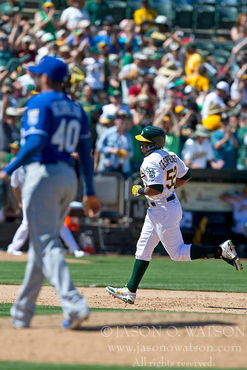 OAKLAND, CA - MAY 19:  Yoenis Cespedes #52 of the Oakland Athletics rounds the bases after hitting a home run of of Kelvin Herrera #40 of the Kansas City Royals during the eighth inning at O.co Coliseum on May 19, 2013 in Oakland, California. The Oakland Athletics defeated the Kansas City Royals 4-3. (Photo by Jason O. Watson/Getty Images) *** Local Caption *** Yoenis Cespedes; Kelvin Herrera